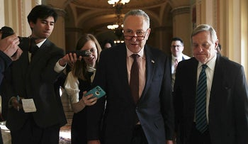 Senate Minority Leader Sen. Chuck Schumer (D-NY) (2nd R) speaks to members of the media as he walks with Senate Minority Whip Sen. Dick Durbin (D-IL) (R) at the Capitol December 1, 2017 in Washington, DC.