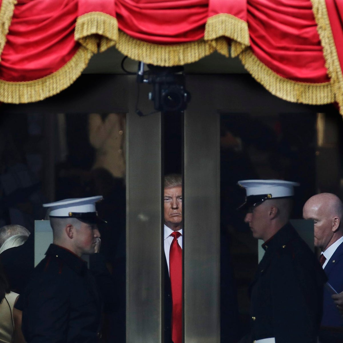 Trump waits to step out onto the portico for his Presidential Inauguration at the U.S. Capitol in Washington, on Jan. 20, 2017.