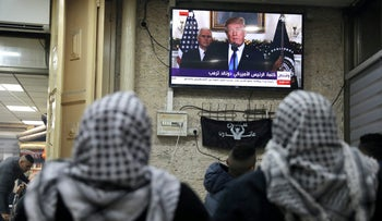 Palestinians watch a televised broadcast of Trump in Jerusalem's Old City December 6, 2017.