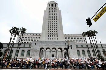 Protesters stand on the steps of Los Angeles City Hall on Monday, Feb. 20, 2017.