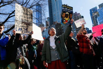 People take part in an 'Not My President's Day' rally in Manhattan, New York, U.S. February 20, 2017.