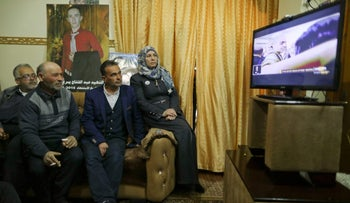The parents and relatives of Palestinian Abd Elfatah Ashareef watch the TV broadcast of the sentencing hearing of Israeli soldier Elor Azaria, in the West Bank City of Hebron February 21, 2017.