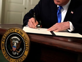 Trump signs a proclamation to recognize Jerusalem as the capital of Israel in the White House, December 6, 2017.