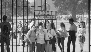 "Tourists at Auschwitz-Birkenau, in a scene from the documentary ""Austerlitz,"" directed by Sergei Loznitsa."