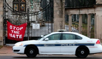 A police patrol car outside the Jewish cemetery near St. Louis, Missouri  that was vandalized on Tuesday.