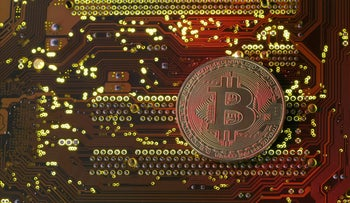 FILE PHOTO: A copy of bitcoin standing on PC motherboard is seen in this illustration picture, October 26, 2017.