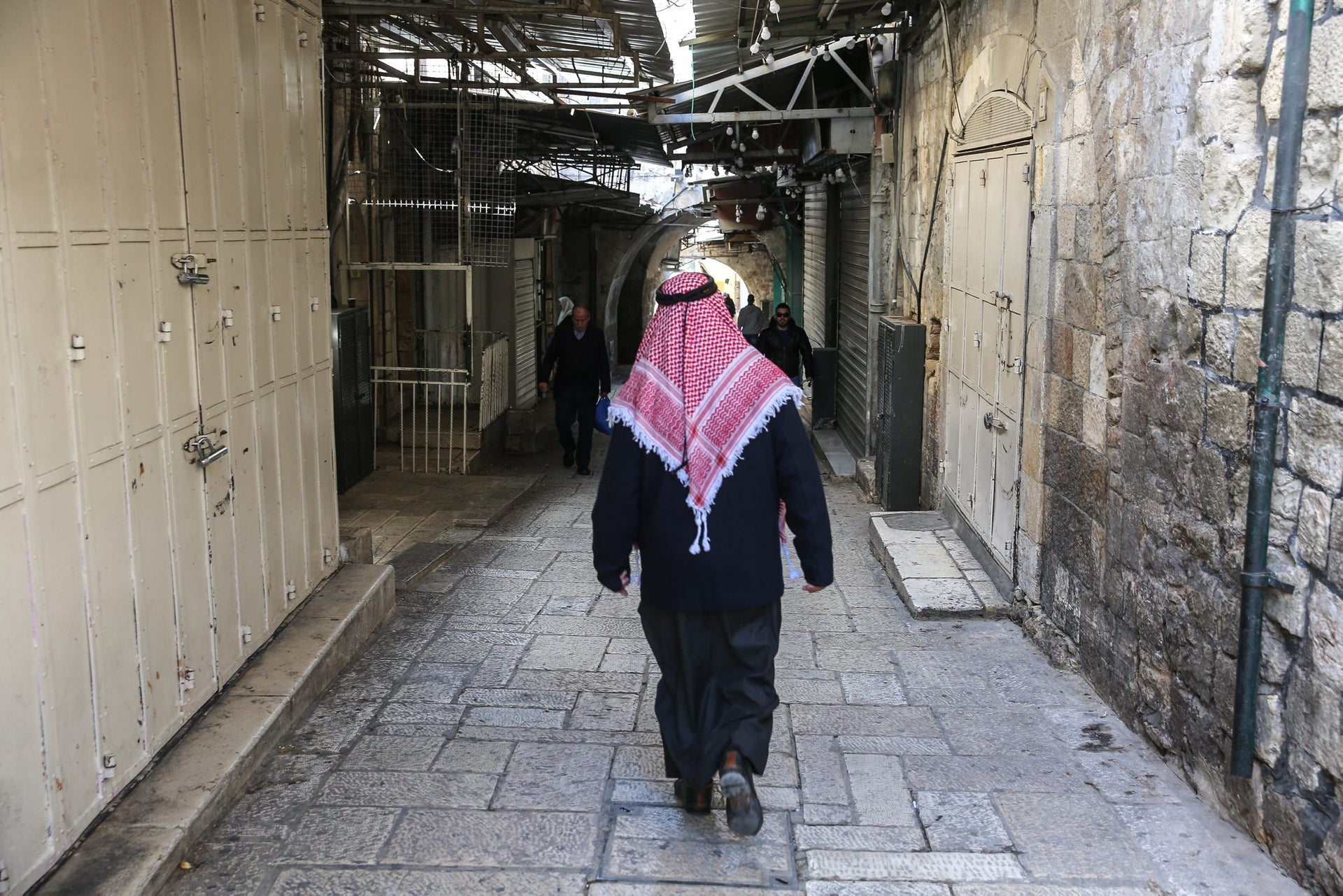 An Arab man walking through the Old City of Jerusalem after Palestinians called a strike in protest at U.S. President Donald Trump's recognition of Jerusalem as the Israeli capital, December 7, 2017.