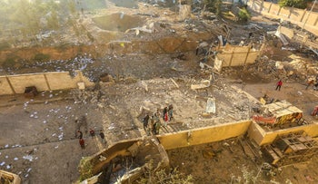 Palestinians look at the damage at a Hamas military facility early on December 9, 2017, in the aftermath of an Israeli air strike in Beit Lahia, in the northern Gaza Strip.