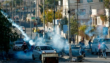 Palestinian protestors clash with Israeli forces near an Israeli checkpoint in the West Bank town of Bethlehem on December 9, 2017.
