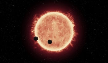 Artist's impression of two Earth-sized worlds passing in front of Trappist-1, an ultracool dwarf star in the Aquarius constellation.