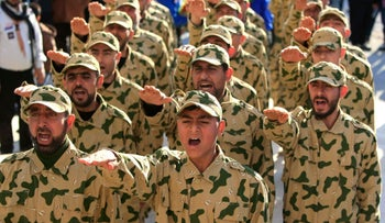 Hezbollah fighters parade during a ceremony to honor fallen comrades, in Tefahta village, south Lebanon, February 18, 2017