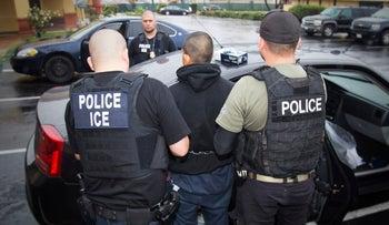U.S. Immigration and Customs Enforcement agents arrest a youth in February 2017, in raids aimed at netting immigration fugitives, re-entrants and at-large criminal aliens in Los Angeles.