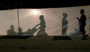 Men and women are separated at a Simhat Torah celebration in a southern community in Israel.