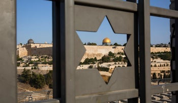 Jerusalem's Old City is seen through a door with the shape of star of David on July 25, 2017