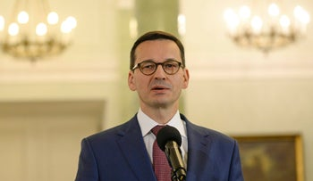 Mateusz Morawiecki speaks to the press after being designated for the post of Poland's Prime Minister in Warsaw, Poland, Friday, Dec. 8, 2017
