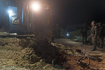 Israeli forces destroy an attack tunnel discovered leading into Israeli territory from Gaza, December 10, 2017.