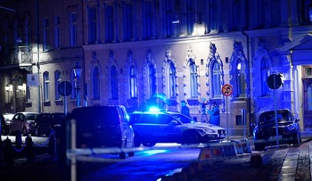 A view of a site where a synagogue was attacked in Gothenburg, Sweden, late Saturday Dec. 9, 2017. Three people was arrested for allegedly throwing firebombs at the synagogue. No one was injured in the attack during a youth event at the synagogue and the adjacent Jewish center in Sweden's second-largest city.