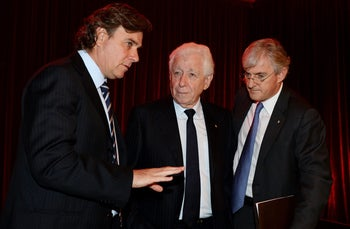 Westfield Chairman Frank Lowy, center, with his sons Peter, left, and Steven, following the company's AGM in Sydney, Australia, on May 29, 2013.