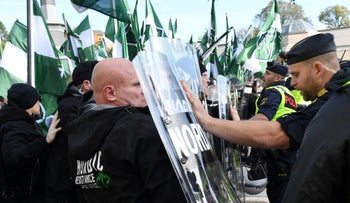 'We know how to identify neo-Nazi Jew-hatred, but we don't talk about Muslim anti-Semitism': Police stop neo-Nazi demonstrators during the Nordic Resistance Movement march in Gothenburg, Sweden. September 30, 2017