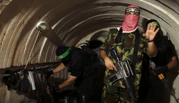 A Palestinian fighter from the armed wing of the Hamas movement inside a tunnel in Gaza, August 18, 2014.