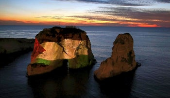 The landmark Raouche sea rock is illuminated by a giant Palestinian flag in Beirut, Lebanon, Saturday, Dec. 9, 2017