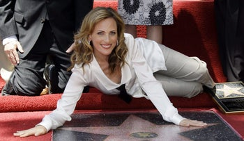 File photo: Actress Marlee Matlin touches her new star on the Hollywood Walk of Fame at dedication ceremonies in Los Angeles on May 6, 2009.