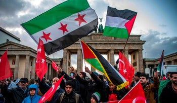 Demonstrators wave Palestinian, Turkish and Syrian flags next to the U.S. embassy in Berlin to protest Trump's declaration of Jerusalem as Israel's capital, December 8, 2017.