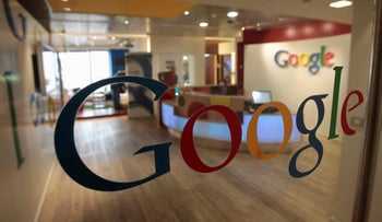 File photo: The Google logo is seen on a door at the company's office in Tel Aviv January 26, 2011.