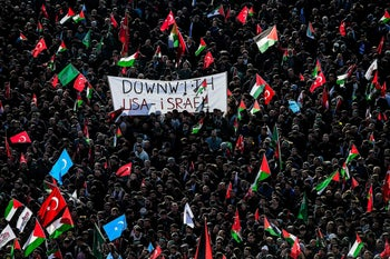 Protesters against Trump's Jerusalem decision chant slogans against America and Israel as they wave Turkish and Palestinian flags on December 10, 2017 during a demonstration in Istanbul