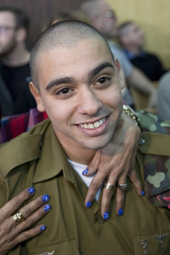 Israeli soldier Elor Azaria is embraced by his mother at his sentencing hearing at a military court in Tel Aviv, Israel February 21, 2017.
