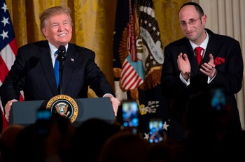 US President Donald Trump speaks alongside Rabbi Meir Soloveitchik during a Hanukkah reception in the East Room of the White House in Washington, DC, December 7, 2017