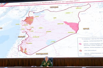 "Col. Gen. Sergei Rudskoi of the military's General Staff speaks during a briefing in the Russian Defense Ministry in Moscow, Russia, Thursday, Dec. 7, 2017. The Russian military said its warplanes recently have operated at an ""unprecedented"" pace to support joint action by Kurdish-led forces and Russian special forces in eastern Syria, flying over 100 missions a day against the Islamic State group. (Vadim Savitsky/ Russian Defense Ministry Press Service pool photo via AP)"