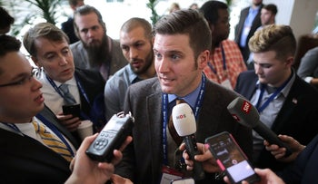 Reporters surround white supremacist Richard Spencer during the first day of the Conservative Political Action Conference, February 23, 2017.