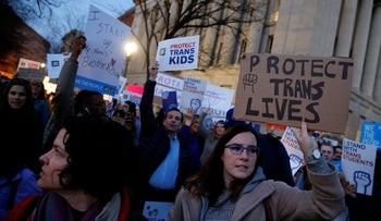 Transgender activists and supporters protest potential changes by the Trump administration in federal guidelines issued to public schools in defense of transgender student rights, near the White House in Washington, U.S. February 22, 2017.