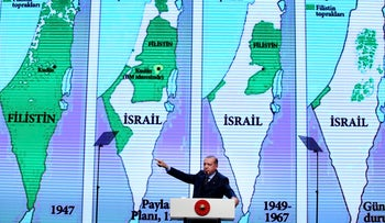 Backdropped by maps of Israel and the Palestinian Territories, Turkey's President Recep Tayyip Erdogan, gestures as talks at the closing ceremony of exporters' innovation and entrepreneurship week event, in Istanbul, Saturday, Dec. 9, 2017.