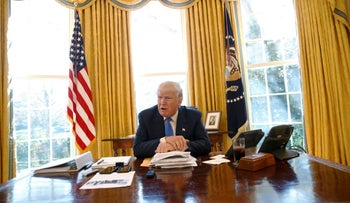 U.S. President Donald Trump gives an interview from his desk in the Oval Office at the White House in Washington, U.S., February 23, 2017.
