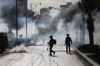 Israeli troops clash with Palestinian protestors in the West Bank city of Ramallah as demonstrations continued to flare over US President Donald Trump's declaration of Jerusalem as Israel's capital. December 11, 2017