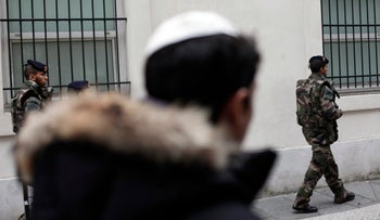 French soldiers patrol next to a Jewish school in Paris, France.