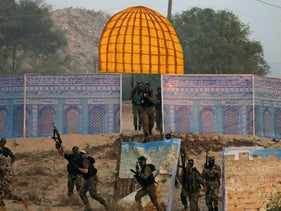 Palestinian militants from the al-Nasser Saladin Brigades drill with a model depicting the Dome of the Rock in Khan Younis, southern Gaza Strip. September 19, 2017