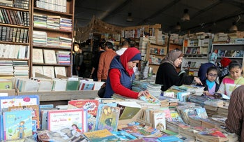 People browsing through books at Cairo's international book fair in Egypt, February 9, 2017.