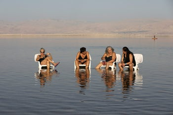 Women sitting on chairs in the Dead Sea in Ein Bokeq, February 20, 2017.