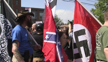 Demonstrators carrying confederate and Nazi flags during the Unite the Right rally in Charlottesville, Virginia, on August 12, 2017.