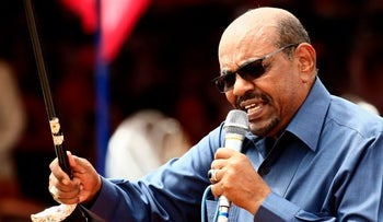 FILE PHOTO: Sudanese President Omar al-Bashir delivering a speech during a visit to the village of Bilel in South Darfur, near the Kalma camp for displaced people on September 22, 2017
