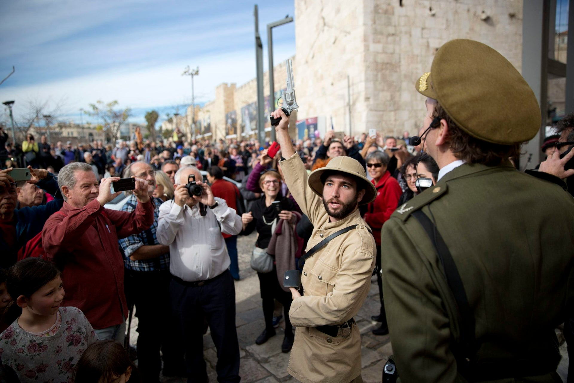 Actors dressed as British soldiers take part the reenactment of the entrance of General Allenby to Jaffa gate in Jerusalem's Old city, December 11, 2017.