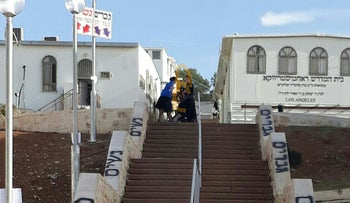 Signs calling for the segregation of men and women spray-painted onto a stairway following the removal of so-called modesty signs, Beit Shemesh, Israel, December 11, 2017.