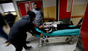 An injured Palestinian man arrives at a hospital to receive treatment following an Israeli air strike in Beit Lahia, northern Gaza Strip, December 8, 2017.
