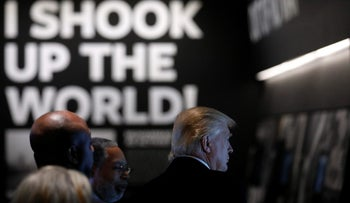 U.S. President Donald Trump looks at an exhibit bearing a quote from Muhammed Ali at the National Museum of African American History and Culture in Washington, U.S., February 21, 2017.