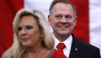 Republican candidate for U.S. Senate Judge Roy Moore smiles while his wife  Kayla delivers remarks during a campaign rally in Midland City, Alabama, U.S., December 11, 2017.
