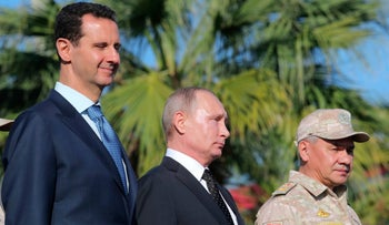 Bashar Assad, Vladimir Putin and Russian Defence Minister Sergei Shoigu at the Khmeimim air base in northern Syria, December 11, 2017.