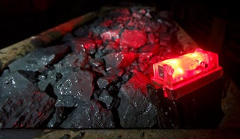 A red rear light sits illuminated on rail trucks loaded with rocks containing uranium ore at Rozna mine in Dolni Rozinka, Czech Republic, on Thursday, April 10, 2014.